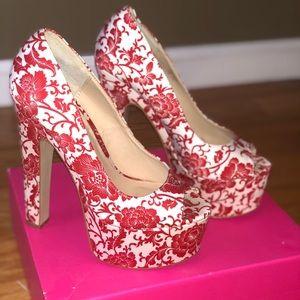 Red and white platform heels